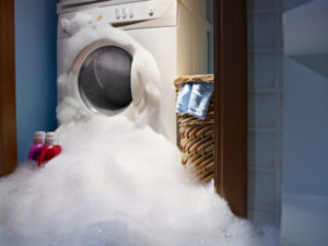 soap coming out from broken washing machine.